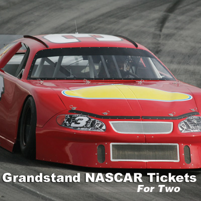 Grandstand NASCAR<sup>&reg;</sup> Tickets - Imagine you and a friend at one of NASCAR's exciting races.  It's the ultimate racing fan experience!  Includes 2 grandstand tickets. Race to be determined based on scheduling. Airfare not included.