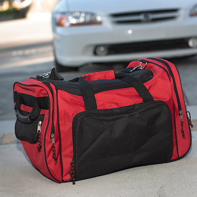 PREMIUMBAG<sup>®</sup> Wheeling Duffel Bag - This duffel bag features adjustable shoulder straps, zippered pockets, u-shaped top zipper opening for main compartment and double web carrying handle with Velcro grip closure.  Also features wheels on one end for easy pulling.  Bag measures 18